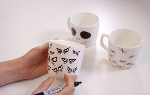 decorating a mug with Halloween themes